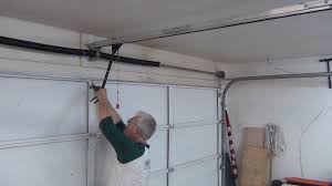 Installing An Overhead Garage Door Door Garage Garage Door Rails Garage Door Cable Repair Garage