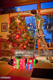 Decorative Christmas Tree Ladders by Son Holding Ladder Mother Decorating Christmas Tree Stock Photo