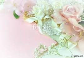 blush satin ribbon silk roses in a pink blush color arranged with vintage lace