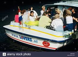 thames river boat hen party women having a hen party on board a tourist boat travelling on a