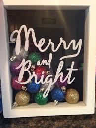cricut vinyl letters on a shadow box for christmas craft ideas