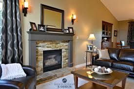 warm earth toned living room with slate stone fireplace surround