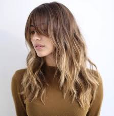 hairstyles with bangs and middle part 12 hairstyles that will make you want bangs again brit co
