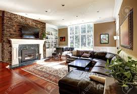 luxury living room with stobe fireplace and leather sofas cherry