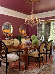 maroon and gold dining room traditional with gold acents table vases