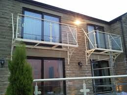 Balcony Design by Bespoke Design Walk Out Balcony With Gallows Brackets And
