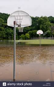 flooded outdoor basketball court stock photo royalty free image