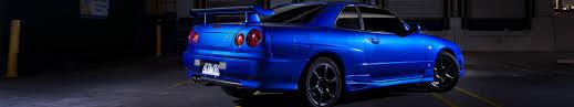 blue nissan skyline car triple screen skyline r34 nissan skyline gt r blue