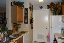 decorating above kitchen cabinets christmas modern cabinets