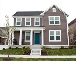blue door white trim smokey gray brown siding love the blue