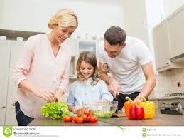 happy family making dinner in kitchen royalty free stock