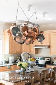 kitchen pot racks with lights hanging the pot rack miss mustard seed