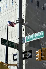 Outside Flag American Flag And Street Sign Outside United Nations Building