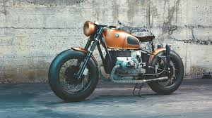 bmw motorcycle orange and black bmw motorcycle before concrete wall free stock