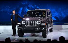 hybrid jeep wrangler jeep and porsche go hybrid and they really do mean business