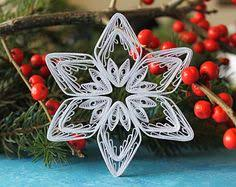 six quilled filigree miniature snowflakes made with bright