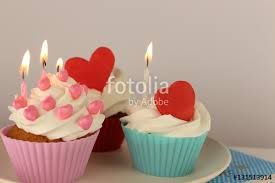 Heart Shaped Items Cupcakes That Is Decorated With Heart Shaped Items And Candles