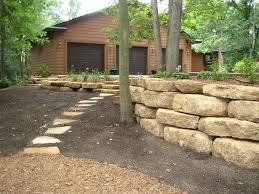 build retaining wall limestone blocks kittleson landscape inc