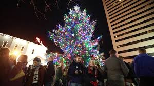 tree lights up at triangle park herald leader