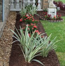How To Start A Flower Garden In Your Backyard Placing Rocks Between The Wall And The Flower Beds Keep The Plants