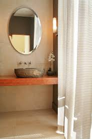 floating vanity with vessel sink stone vessel sinks powder room southwestern with brass carved wood