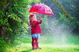 little with red umbrella playing in the rain kids play