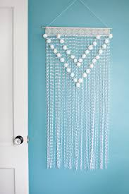 pom pom wall hanging a beautiful mess walls wall hangings and