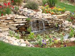 backyard landscaping house design with small ponds surrounded by