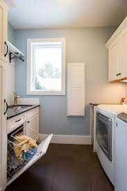 top load washer with sink laundry cabinet with her laundry room transitional with farmhouse