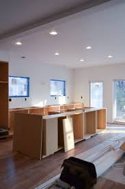 nstalling kitchen cabinets by observing the gap between the top