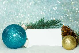 blue and gold ornaments with spruce boughs on a sparkle