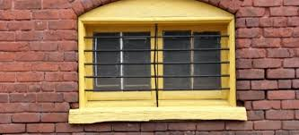 How To Cover Basement Windows by How To Install Basement Window Bars Doityourself Com
