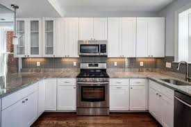 Small Kitchen Remodel Featuring Slate Tile Backsplash by White Kitchen With Slate Appliances Google Search Kitchen