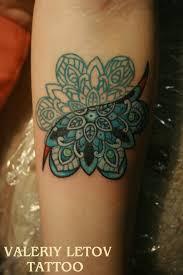 lotus mandala tattoo on shoulder