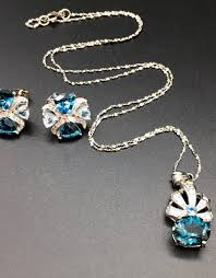 silver pendant necklace set images Sterling silver aquamarine blue topaz earrings and pendant jpg