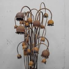 steel poppy garden ornament in clay description from