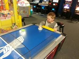 kids air hockey table a kids air hockey table and a full size table picture of action