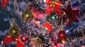 beautifully decorated christmas tree and red star stock video