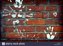 white paint handprints red brick wall art graffiti love heart