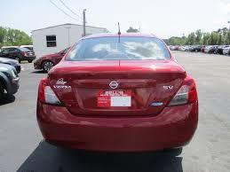 red nissan versa bell u0027s auto sales inc 2012 nissan versa sv 4d sedan