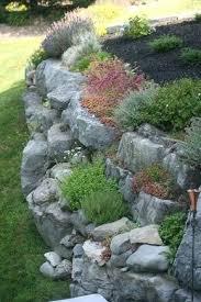 rocks garden rock garden on retaining wall gardening gazette off