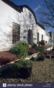 Dutch Colonial Style Settler History Dutch Colonial Style House White Washed Walls Wine