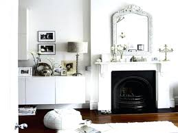 hanging mirror over fireplace mantel wondrous wall clock above