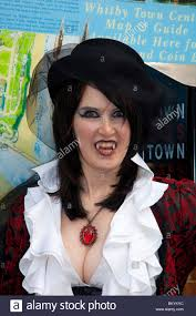 woman wearing halloween fancy dress costumes dracula vampire teeth