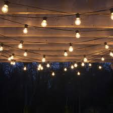 Hanging Patio Lights String How To Plan And Hang Patio Lights Patio Lighting Pergolas And