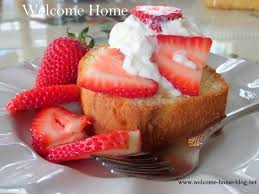 welcome home blog pound cake with whipped cream and strawberries