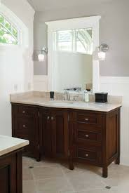 wall color and white wainscot dark cabinet light countertop