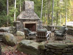 Outdoor Fireplace Surround by Comfy Brown Backyard Garden Seating Area Set In Front Of An