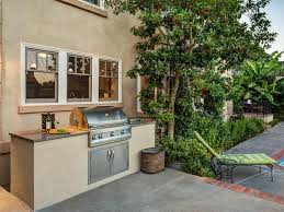 beadboard pavers pergola stone fireplace surround outdoor kitchen