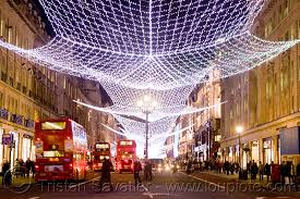 london christmas street lights decorations red double decker buses